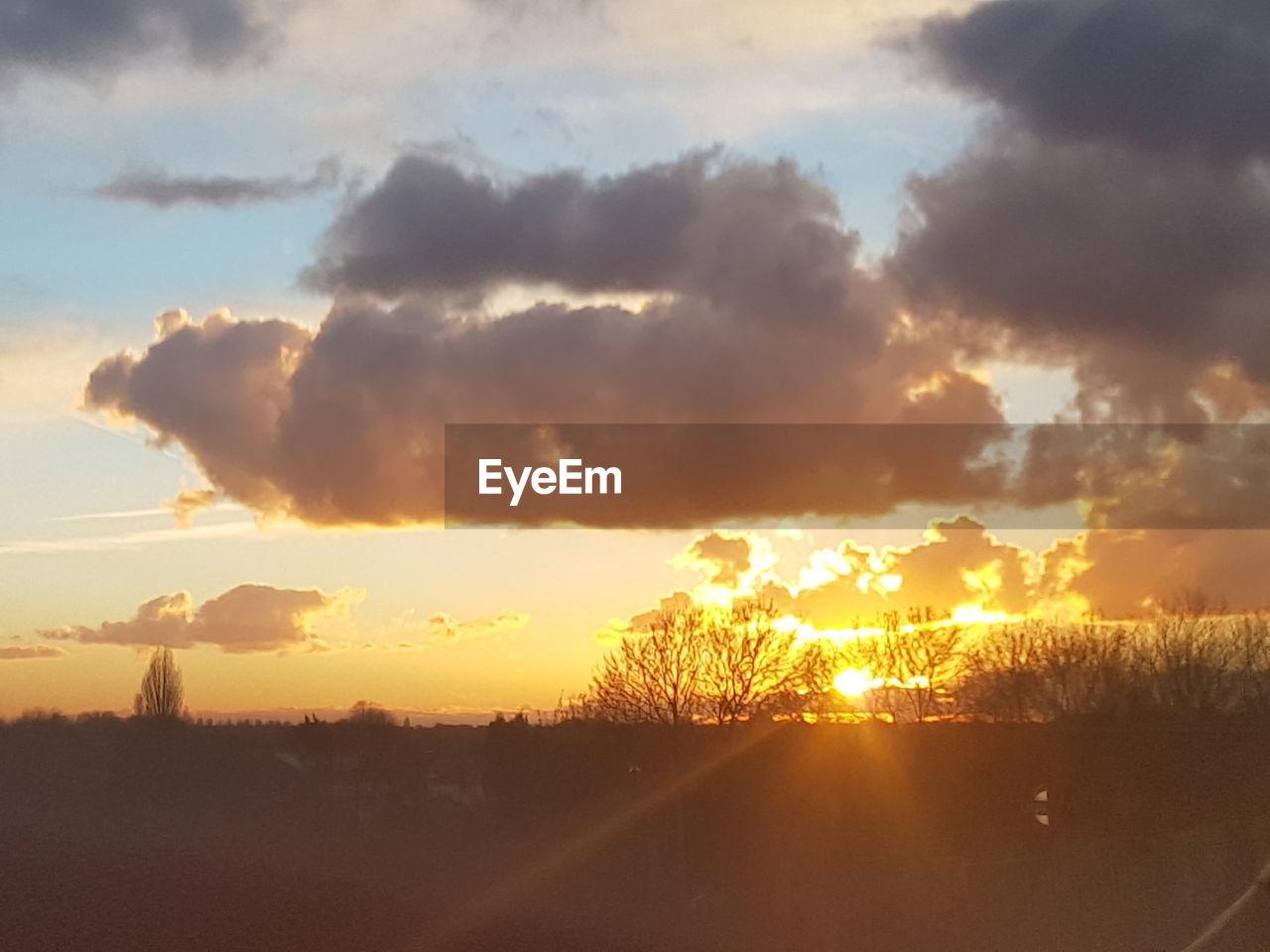 sunset, sky, sun, scenics, cloud - sky, landscape, tranquil scene, orange color, sunbeam, nature, no people, sunlight, tranquility, beauty in nature, silhouette, field, outdoors, road, tree, rural scene, day