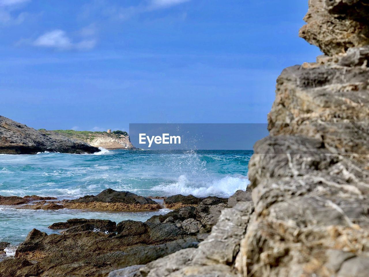 sea, rock, water, rock - object, solid, beauty in nature, beach, land, sky, scenics - nature, rock formation, day, nature, motion, wave, no people, blue, tranquil scene, tranquility, horizon over water, outdoors, rocky coastline