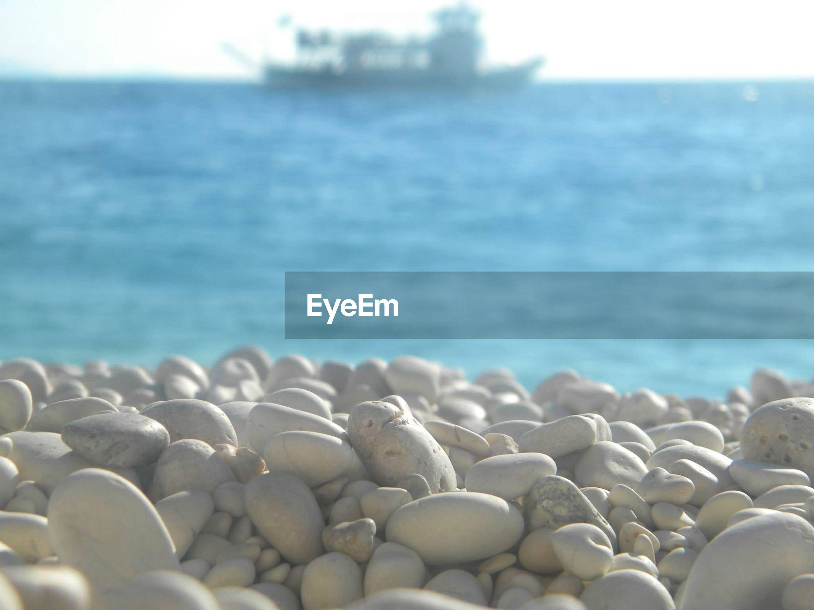 Pebbles on rocky shore