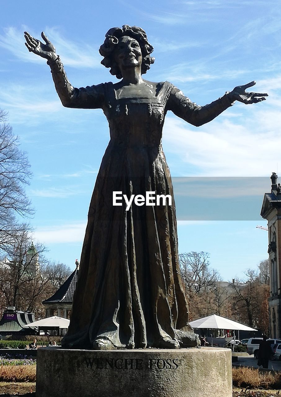 statue, sculpture, human representation, representation, art and craft, creativity, sky, architecture, female likeness, cloud - sky, nature, male likeness, day, no people, memorial, built structure, grave, craft, belief, cemetery, outdoors, angel, arms raised