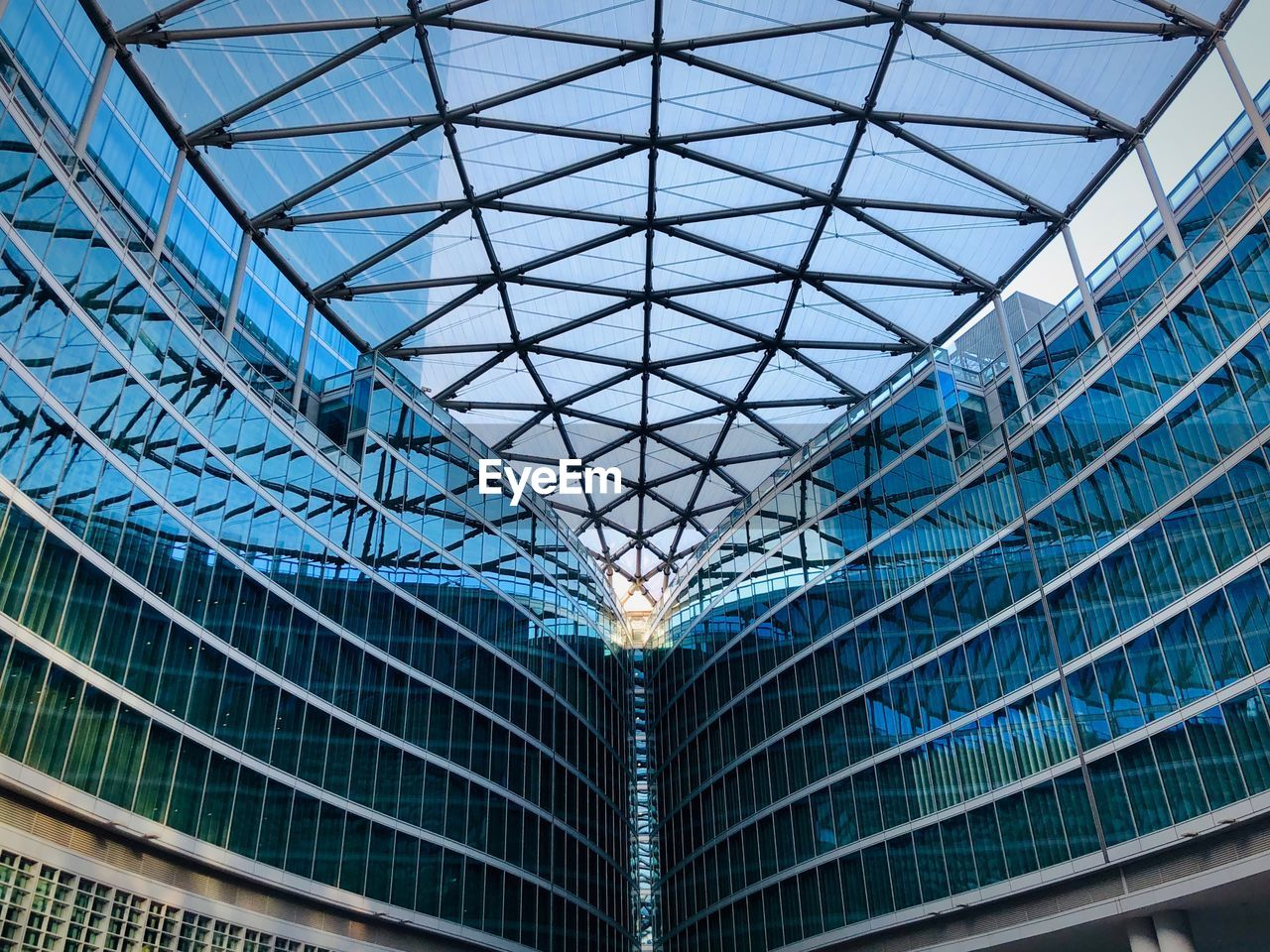 architecture, built structure, city, building exterior, glass - material, modern, no people, building, pattern, day, blue, ceiling, low angle view, sky, full frame, office building exterior, symmetry, metal, outdoors, skyscraper, glass, consumerism