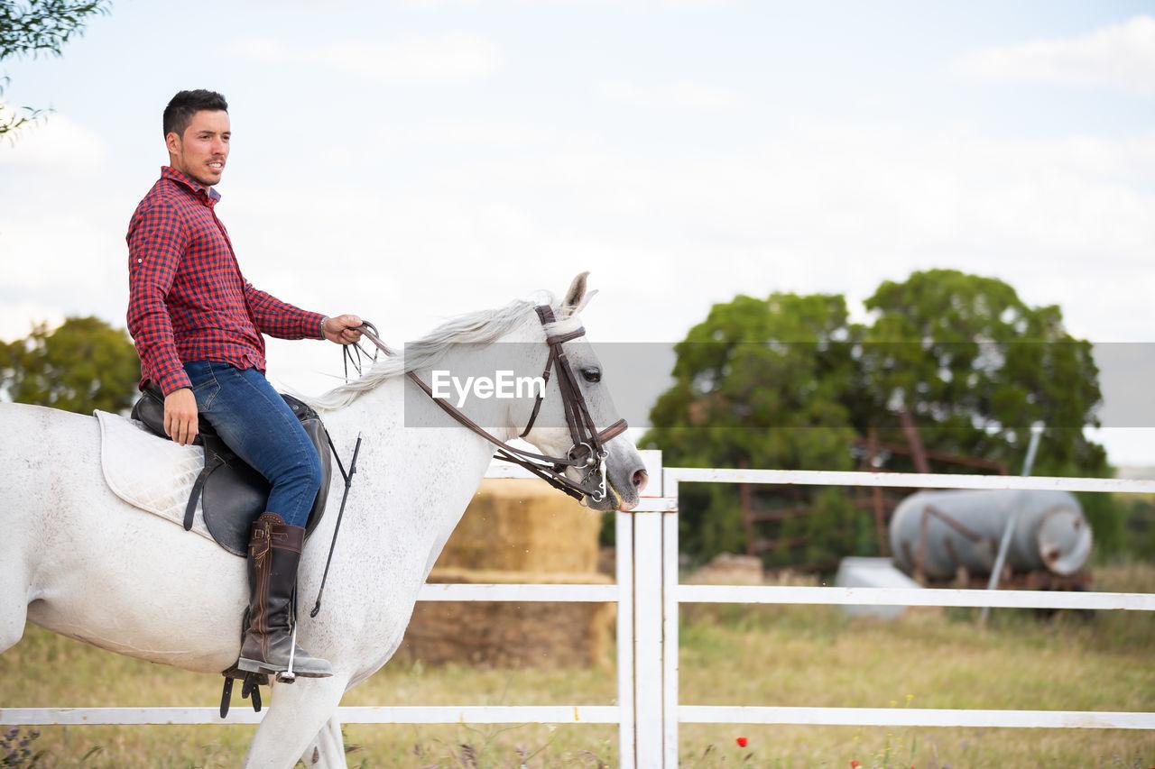 SENIOR MAN RIDING HORSE