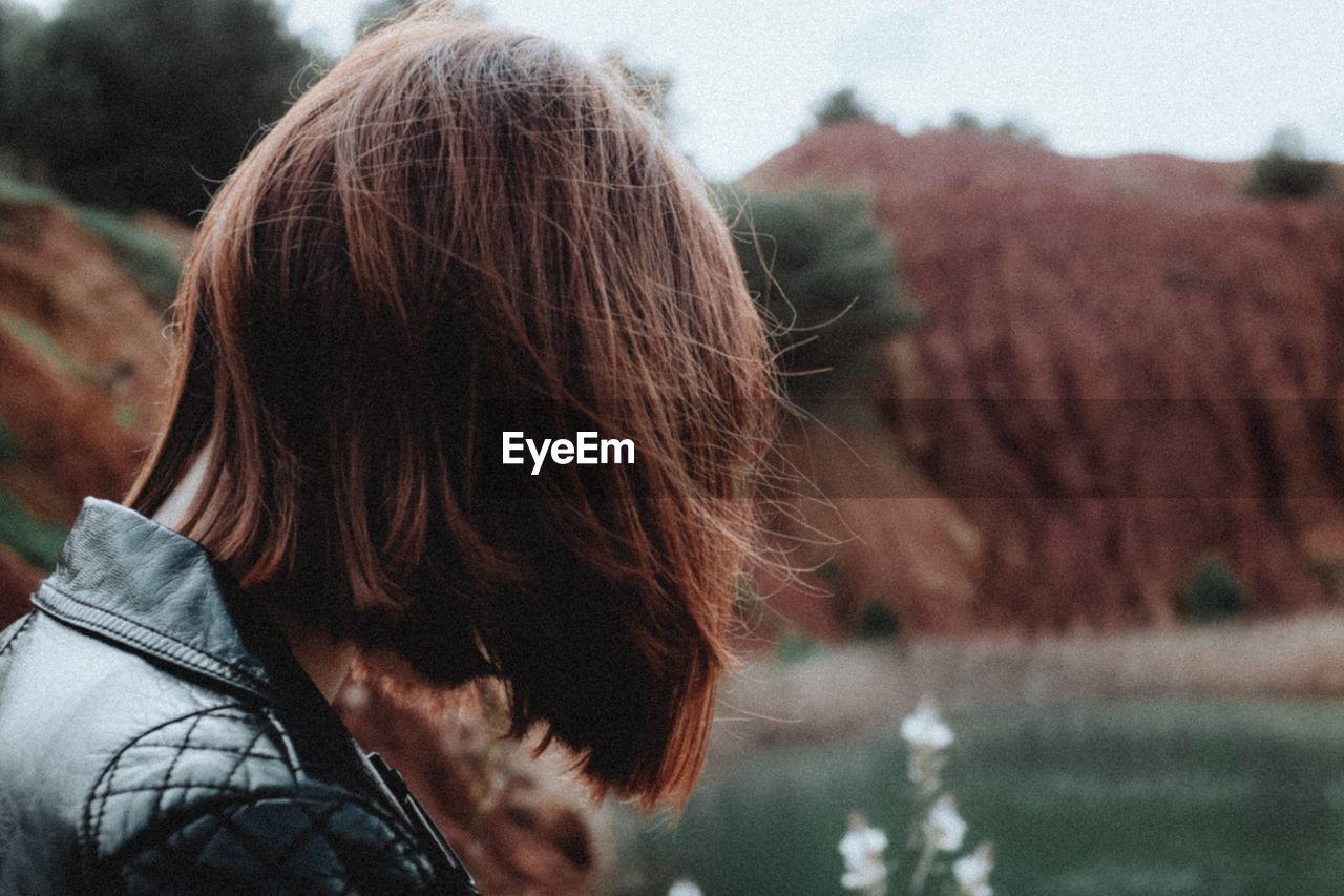 Close-Up Of Woman Looking At River