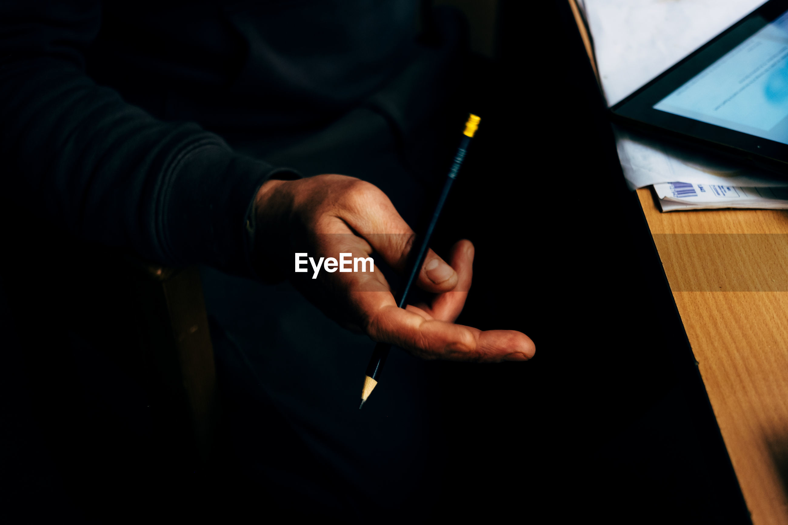 Close-up of man holding pencil
