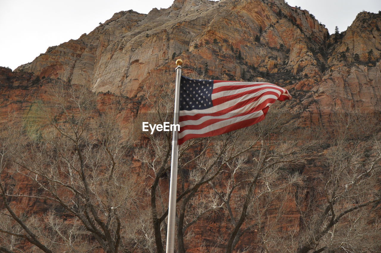 Low Angle View Of American Flag At Zion National Park