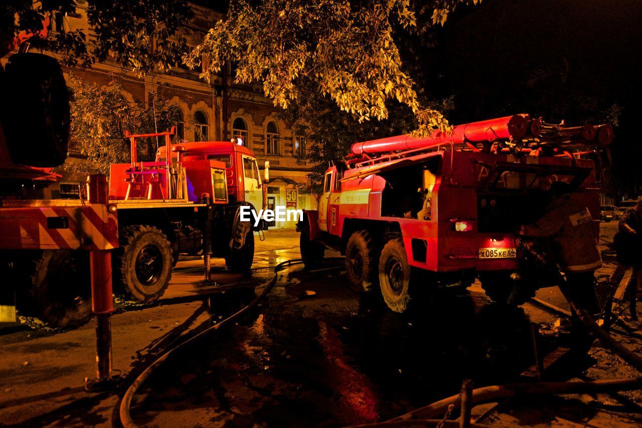 night, transportation, outdoors, mode of transport, land vehicle, fire engine, illuminated, red, no people, occupation