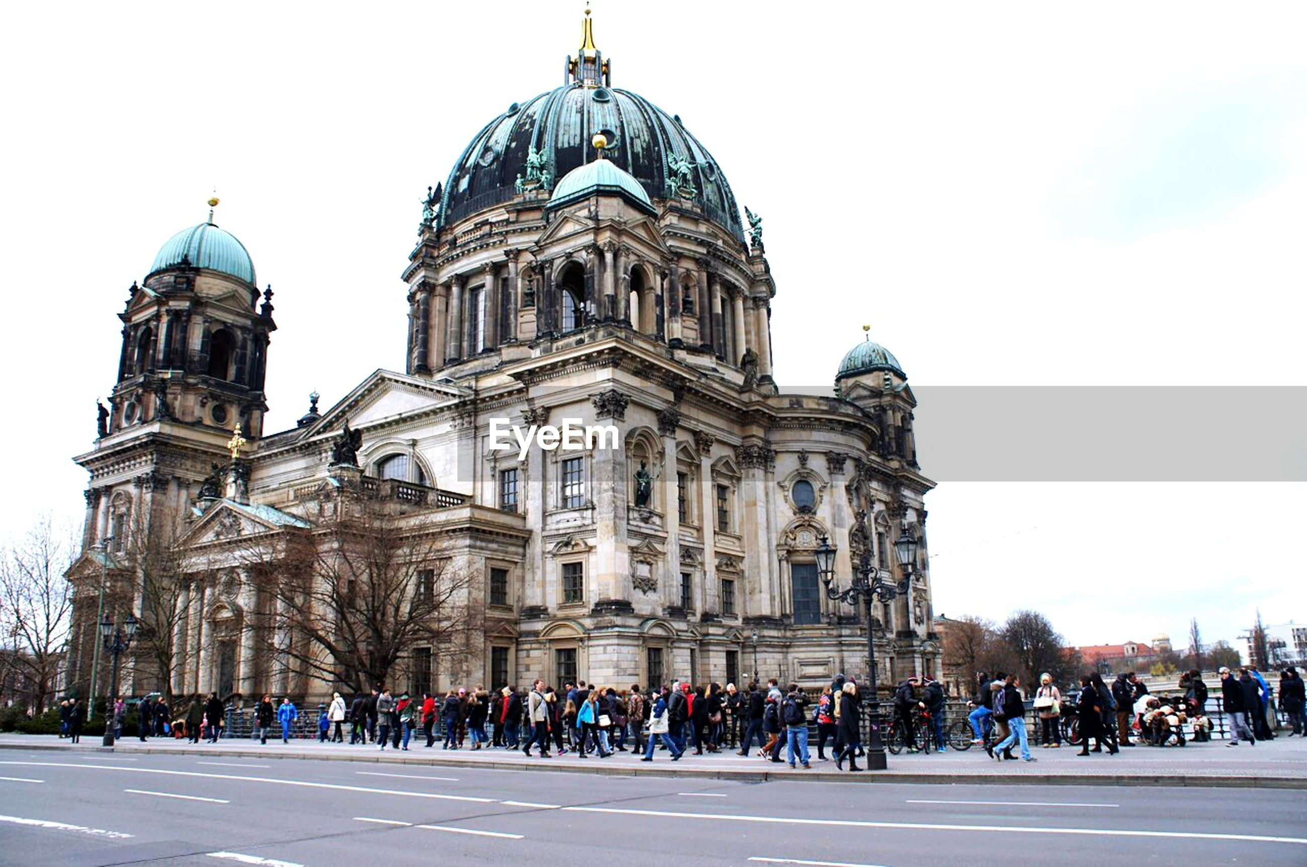 architecture, building exterior, large group of people, built structure, religion, famous place, place of worship, travel destinations, tourism, church, international landmark, spirituality, cathedral, dome, travel, tourist, person