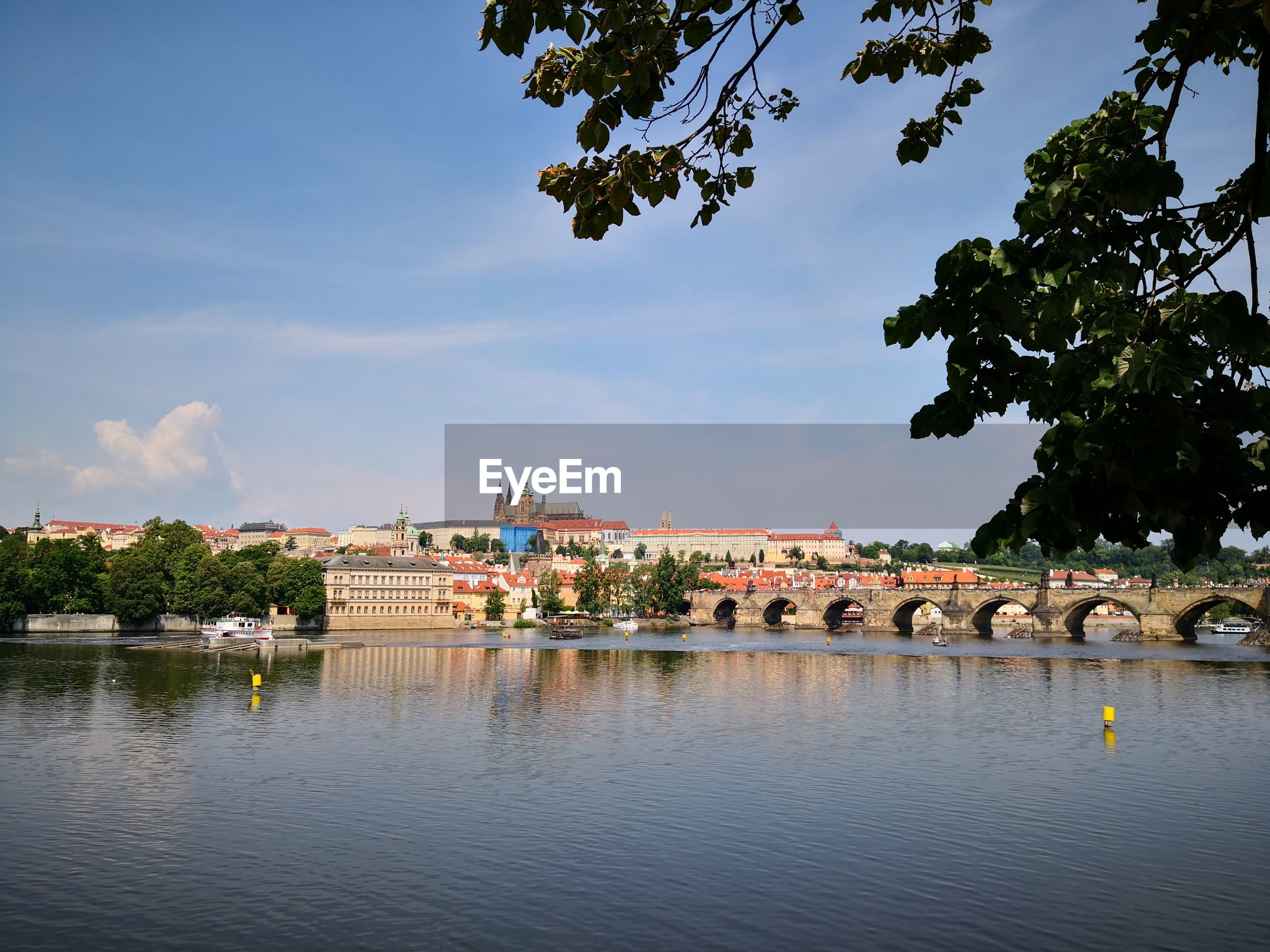 SCENIC VIEW OF RIVER AGAINST BUILDINGS