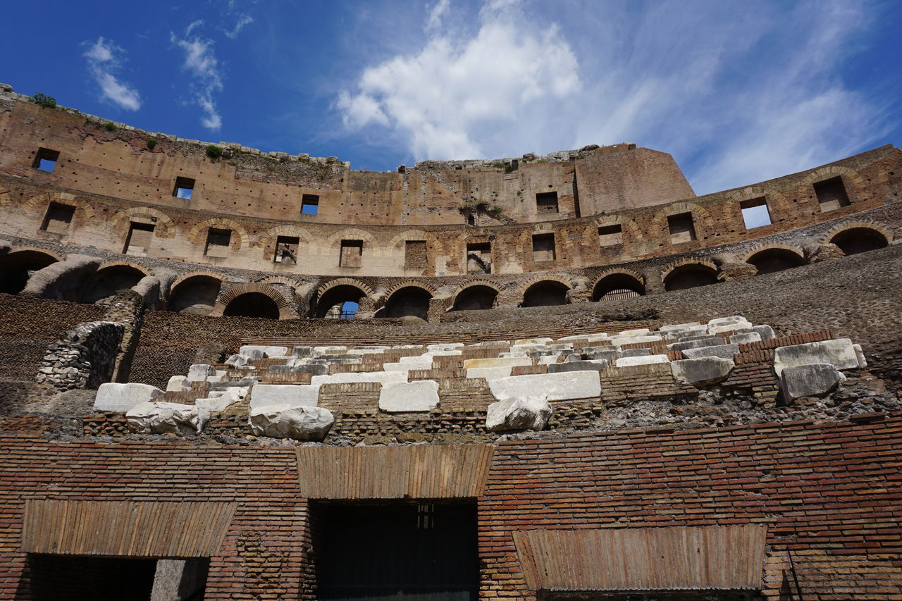 architecture, history, sky, built structure, the past, ancient, cloud - sky, arch, low angle view, old ruin, building exterior, nature, no people, amphitheater, day, ancient civilization, travel destinations, arts culture and entertainment, tourism, archaeology, ruined, ancient history