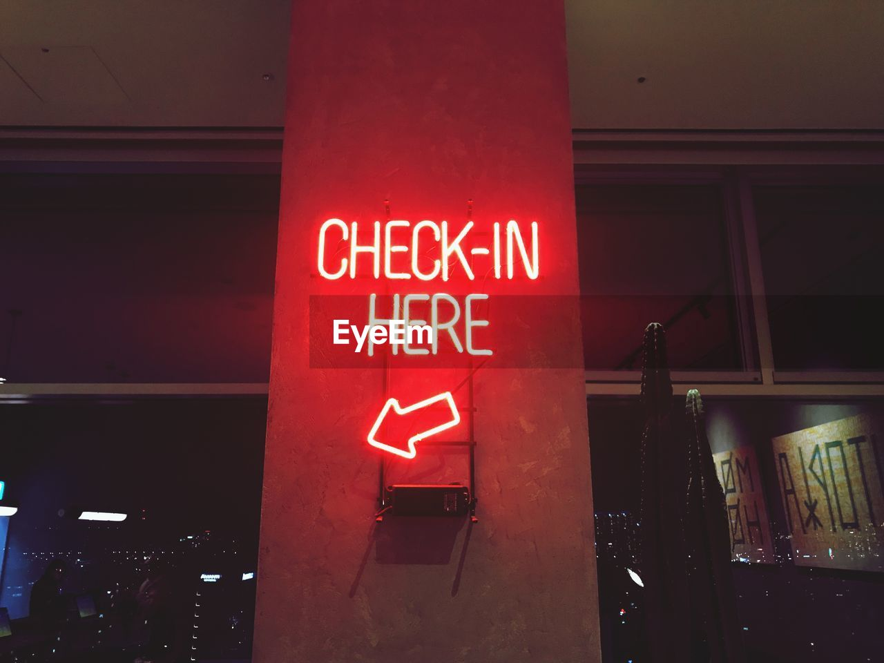 text, communication, illuminated, western script, red, architecture, sign, night, capital letter, built structure, no people, building exterior, information, lighting equipment, neon, city, low angle view, information sign, wall - building feature, ceiling, parking garage, message