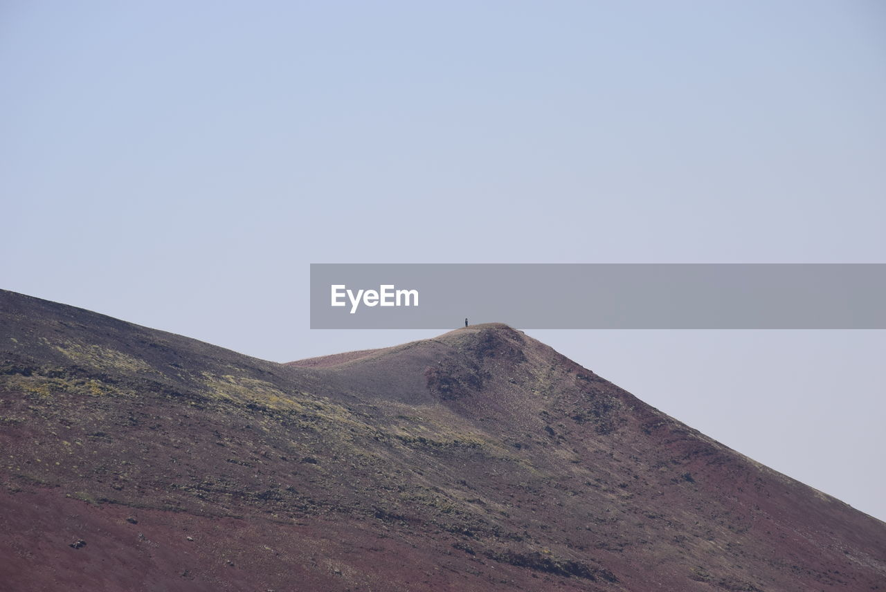 sky, copy space, clear sky, mountain, nature, tranquil scene, scenics - nature, tranquility, day, beauty in nature, environment, landscape, no people, land, non-urban scene, outdoors, low angle view, idyllic, blue, mountain peak, arid climate