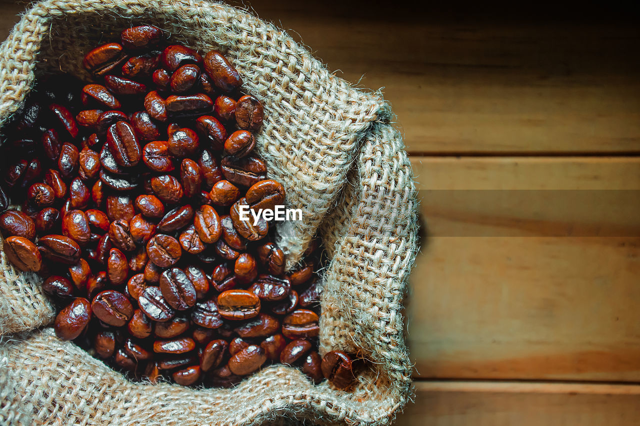 food and drink, food, freshness, still life, wellbeing, indoors, healthy eating, brown, no people, close-up, sack, large group of objects, table, abundance, roasted coffee bean, raw food, bean, wood - material, high angle view, jute, caffeine