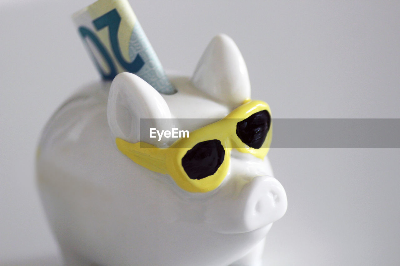 representation, animal representation, indoors, toy, close-up, studio shot, no people, piggy bank, savings, still life, investment, animal, finance, white background, single object, white color, art and craft, cut out, figurine, coin bank