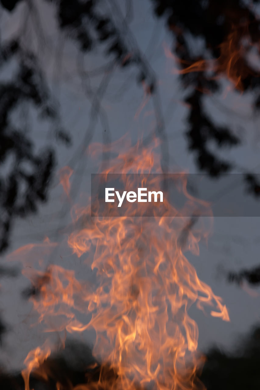 heat - temperature, burning, orange color, fire - natural phenomenon, fire, flame, motion, nature, smoke - physical structure, no people, sky, glowing, cloud - sky, land, environment, outdoors, warning sign, blurred motion, close-up, sign, bonfire, pollution