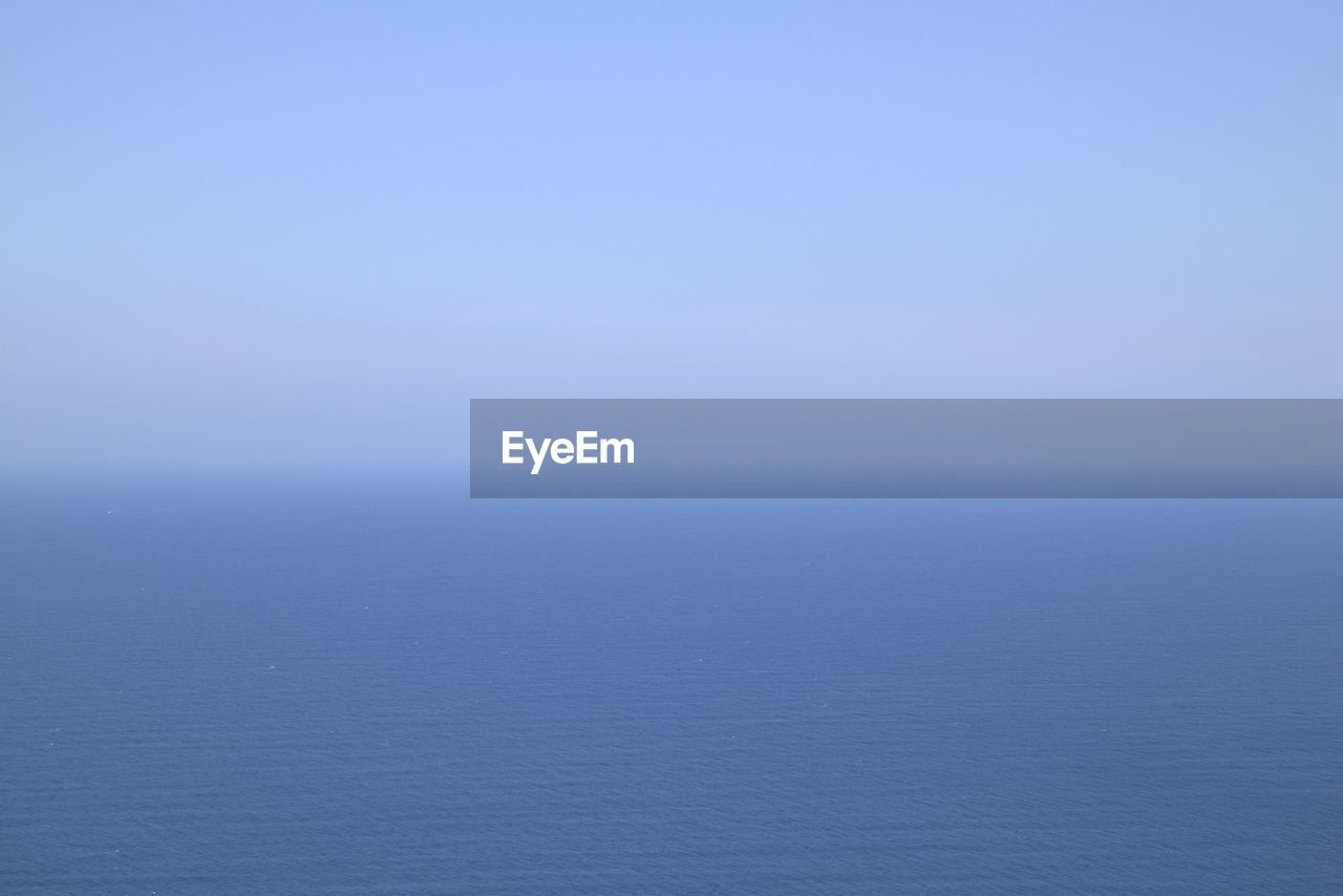 IDYLLIC VIEW OF SEA AGAINST CLEAR SKY