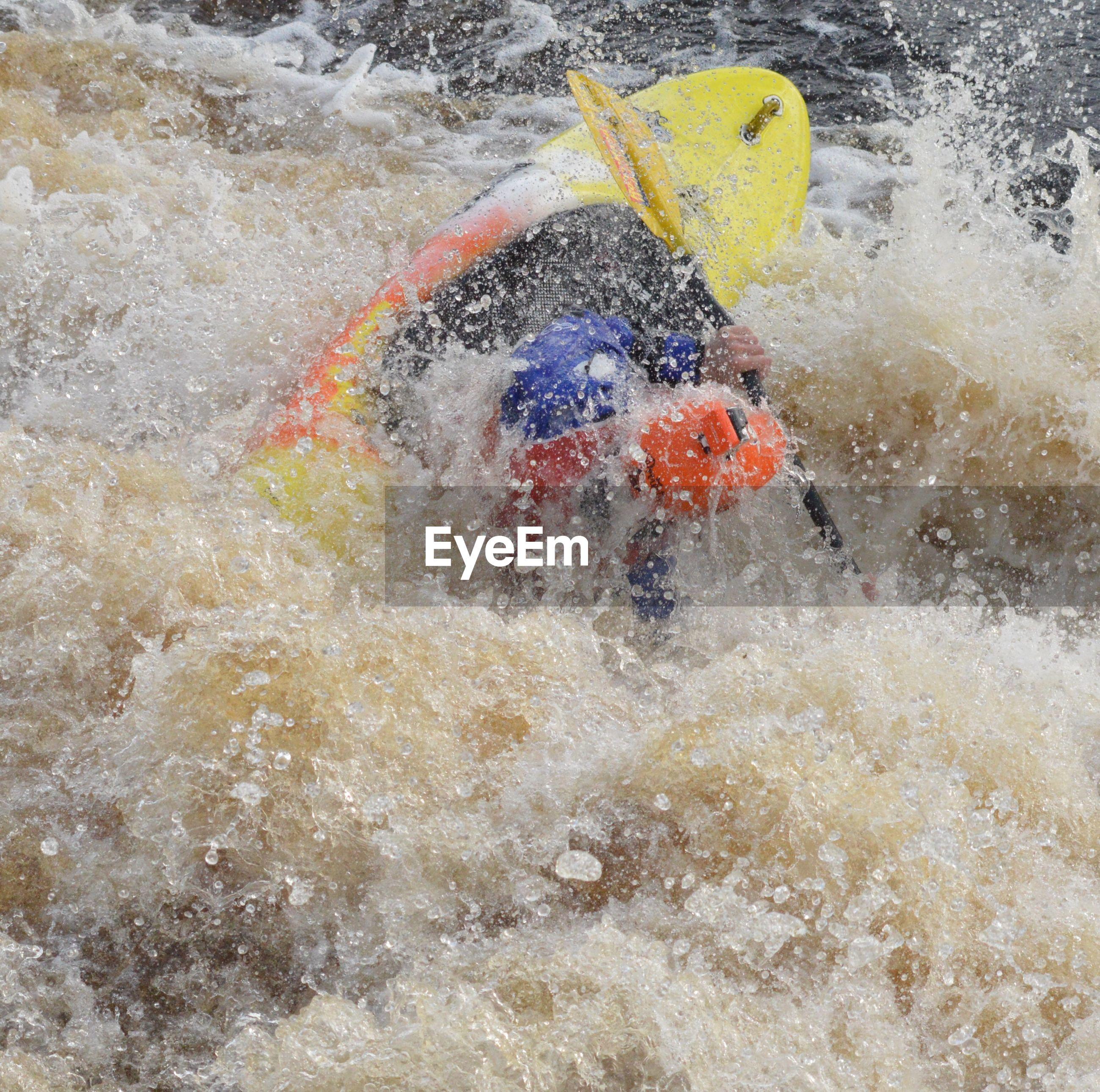 High angle view of man kayaking on river