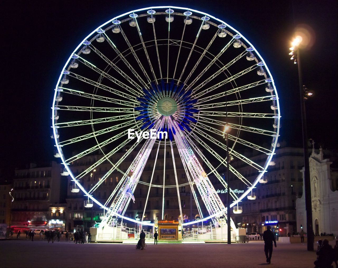 illuminated, night, ferris wheel, arts culture and entertainment, amusement park, leisure activity, built structure, sky, low angle view, clear sky, big wheel, outdoors, architecture, no people