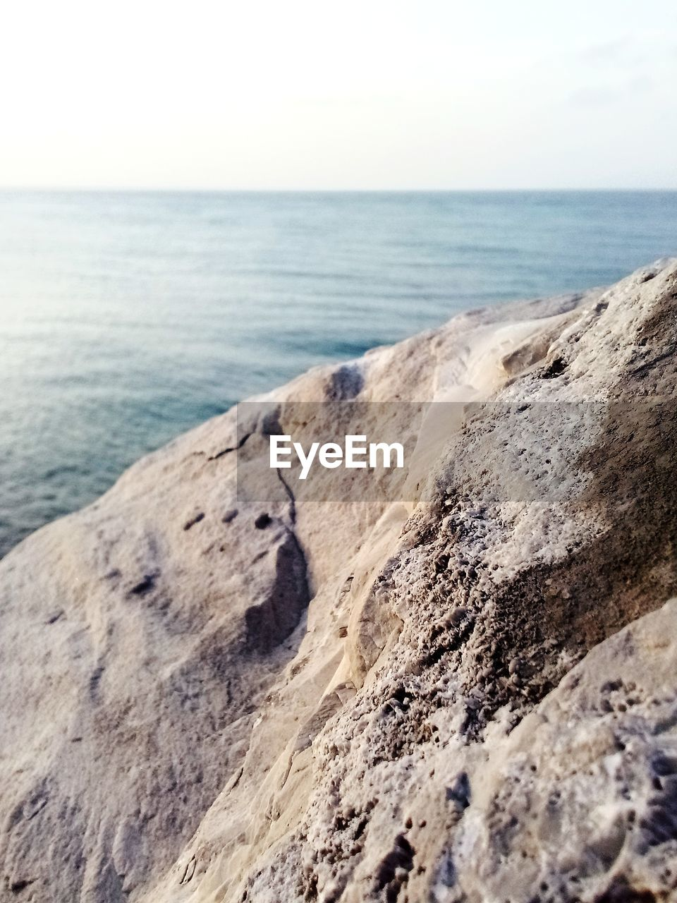 sea, horizon, horizon over water, sky, water, scenics - nature, beauty in nature, land, beach, tranquility, tranquil scene, nature, no people, rock, day, rock - object, solid, idyllic, outdoors
