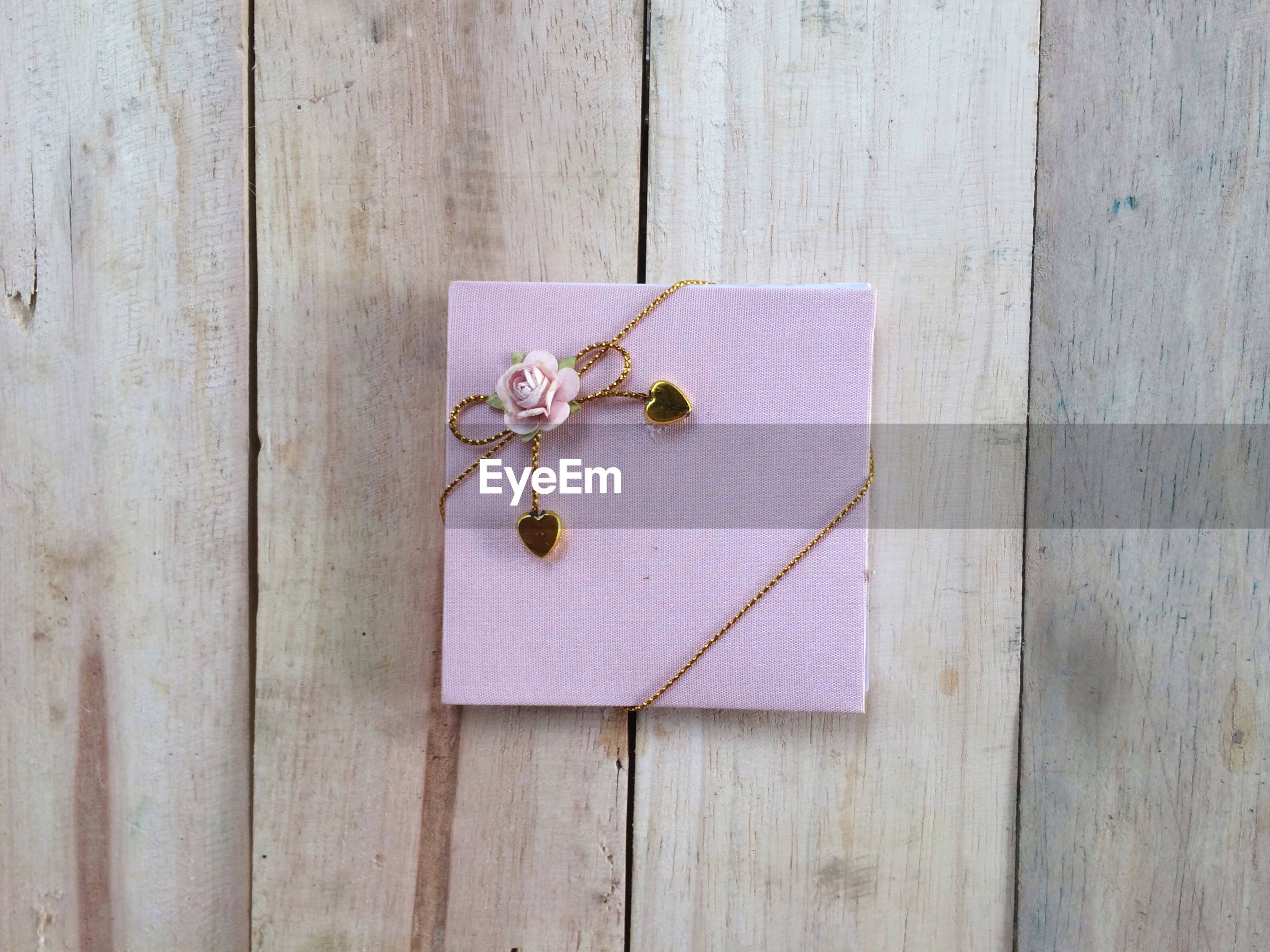 High angle view of envelope on wooden table