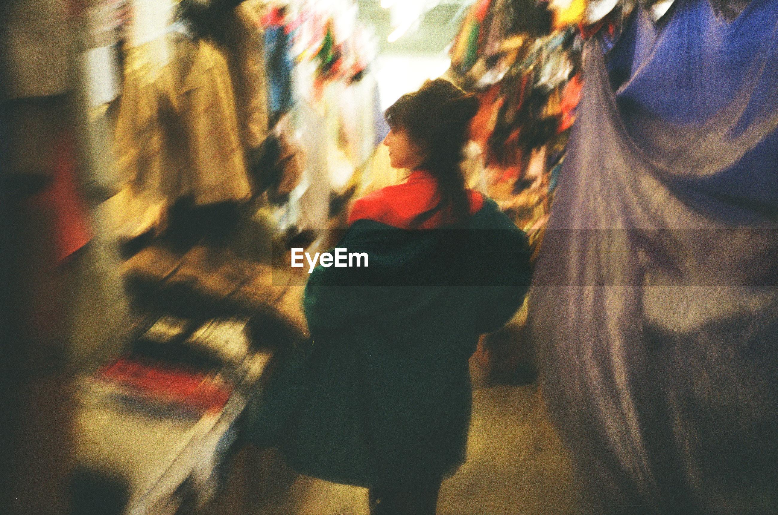 BLURRED IMAGE OF WOMAN WALKING ON STREET
