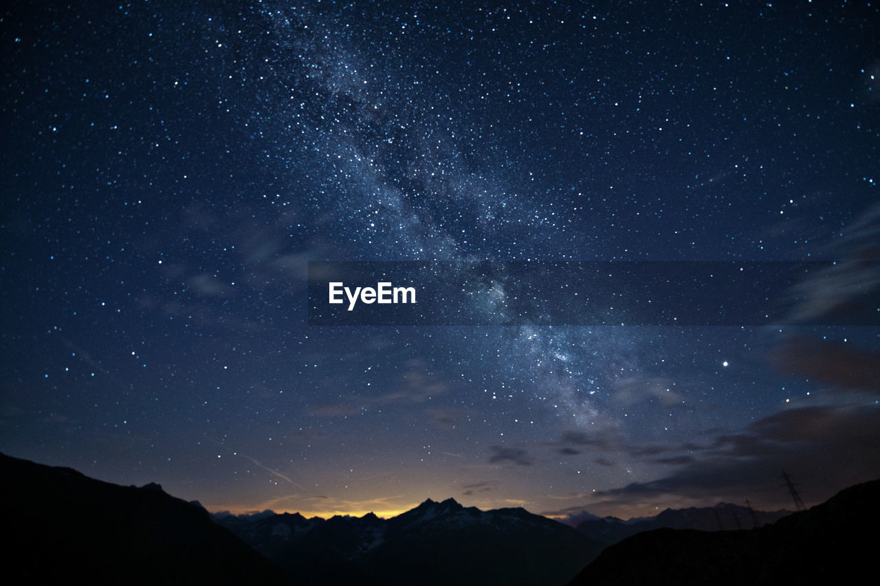 star - space, scenics - nature, space, mountain, beauty in nature, astronomy, night, sky, tranquility, tranquil scene, galaxy, mountain range, nature, star, no people, star field, non-urban scene, idyllic, milky way, environment, outdoors, mountain peak