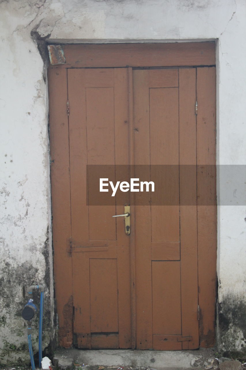 door, entrance, architecture, security, safety, closed, built structure, protection, building exterior, building, no people, day, house, wall - building feature, wood - material, outdoors, residential district, open, white color, front door, garage