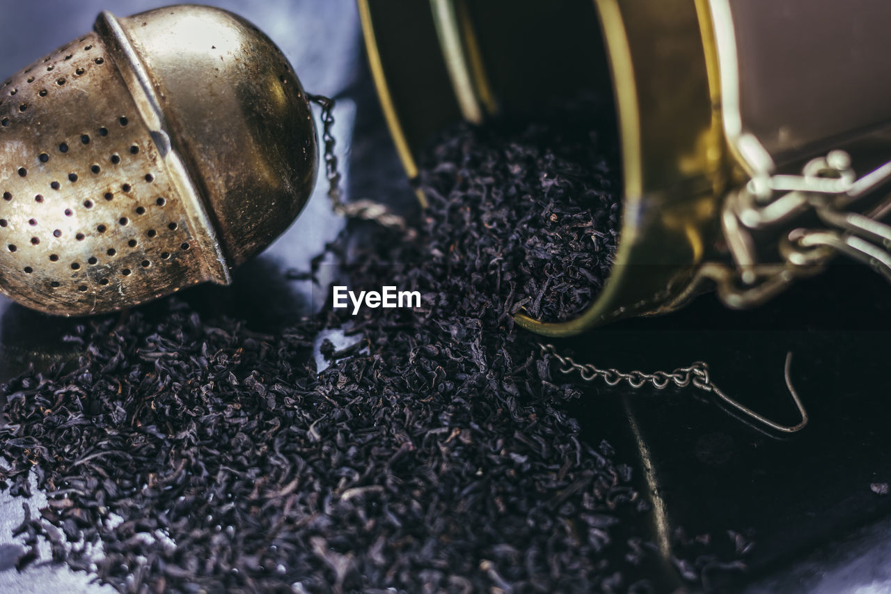 Close-Up Of Black Tea And Infuser