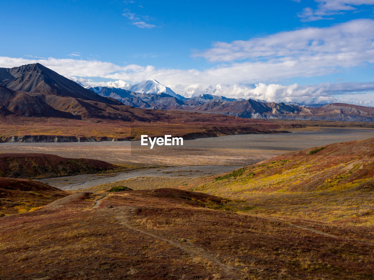 Expansive view of the autumn tundra, valleys, braided riverbeds of denali national park, alaska.
