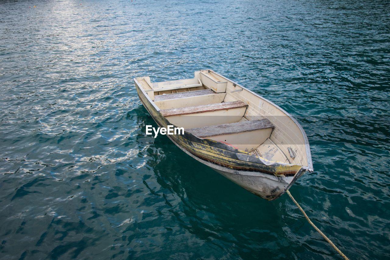 Boat Moored In Calm Lake