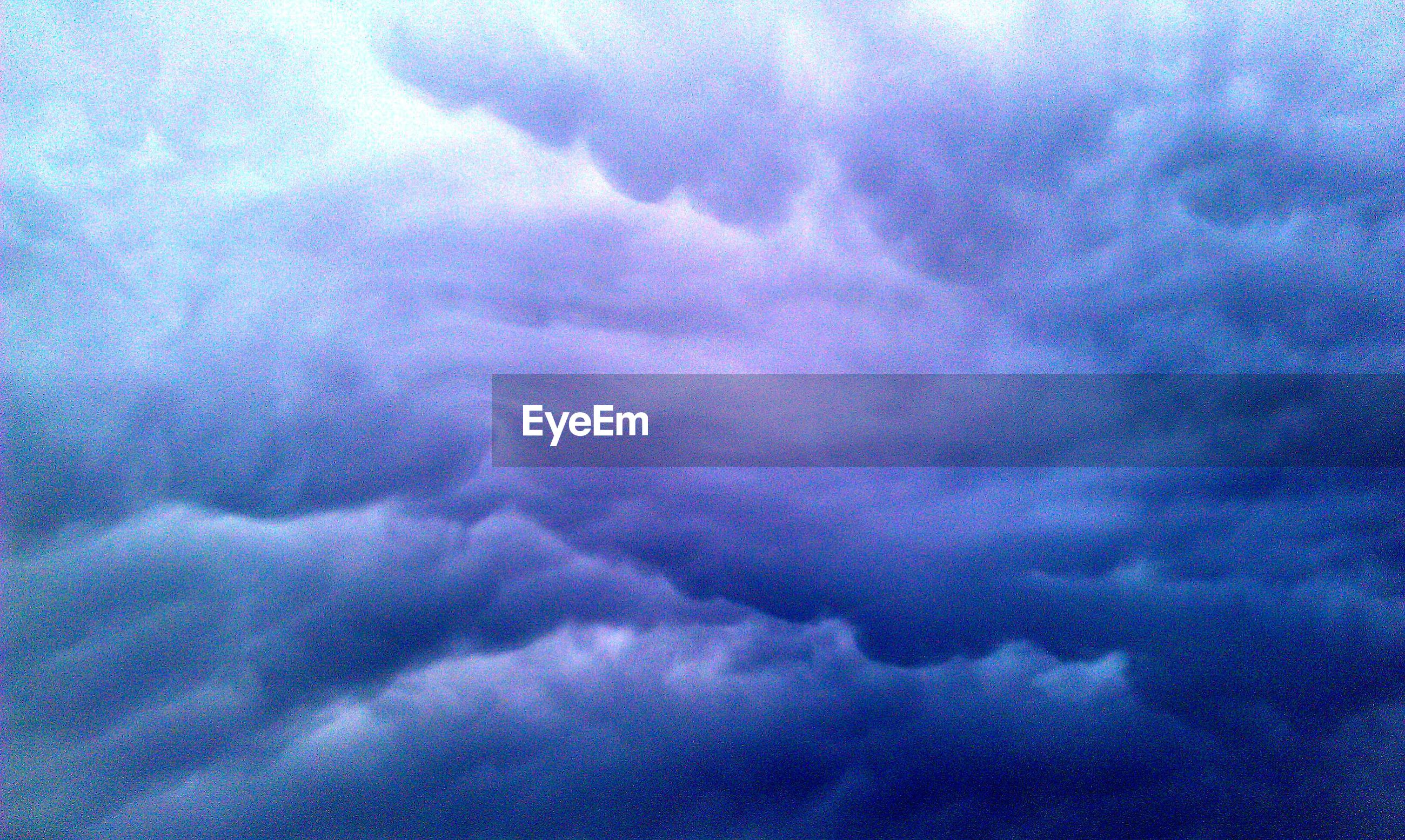 sky, cloud - sky, cloudy, cloudscape, beauty in nature, low angle view, weather, scenics, tranquility, sky only, storm cloud, nature, overcast, tranquil scene, cloud, backgrounds, dramatic sky, blue, idyllic, full frame