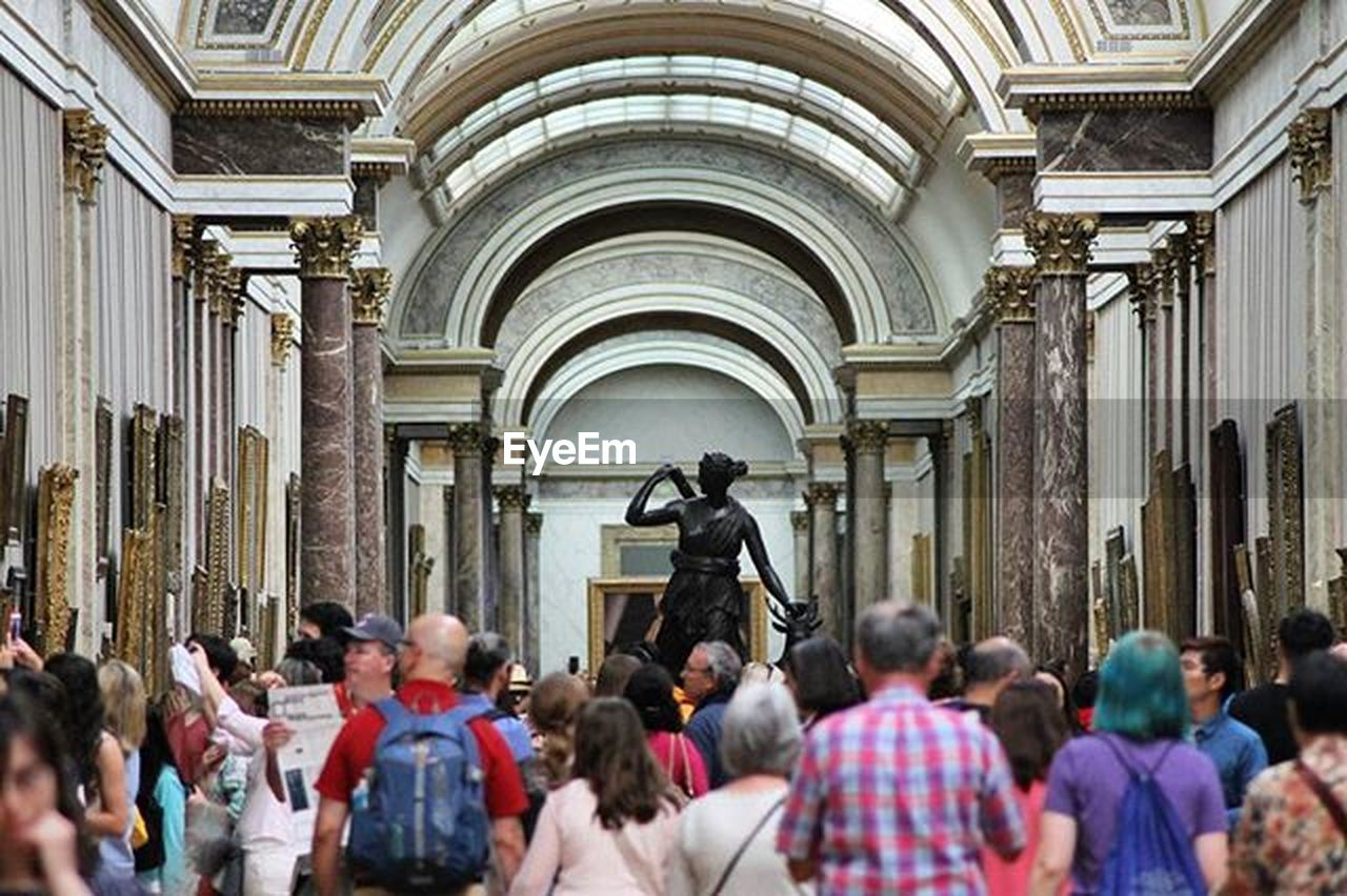 large group of people, architecture, history, statue, built structure, travel destinations, real people, building exterior, day, men, people, law, crowd, outdoors, city, baroque style, adult, adults only