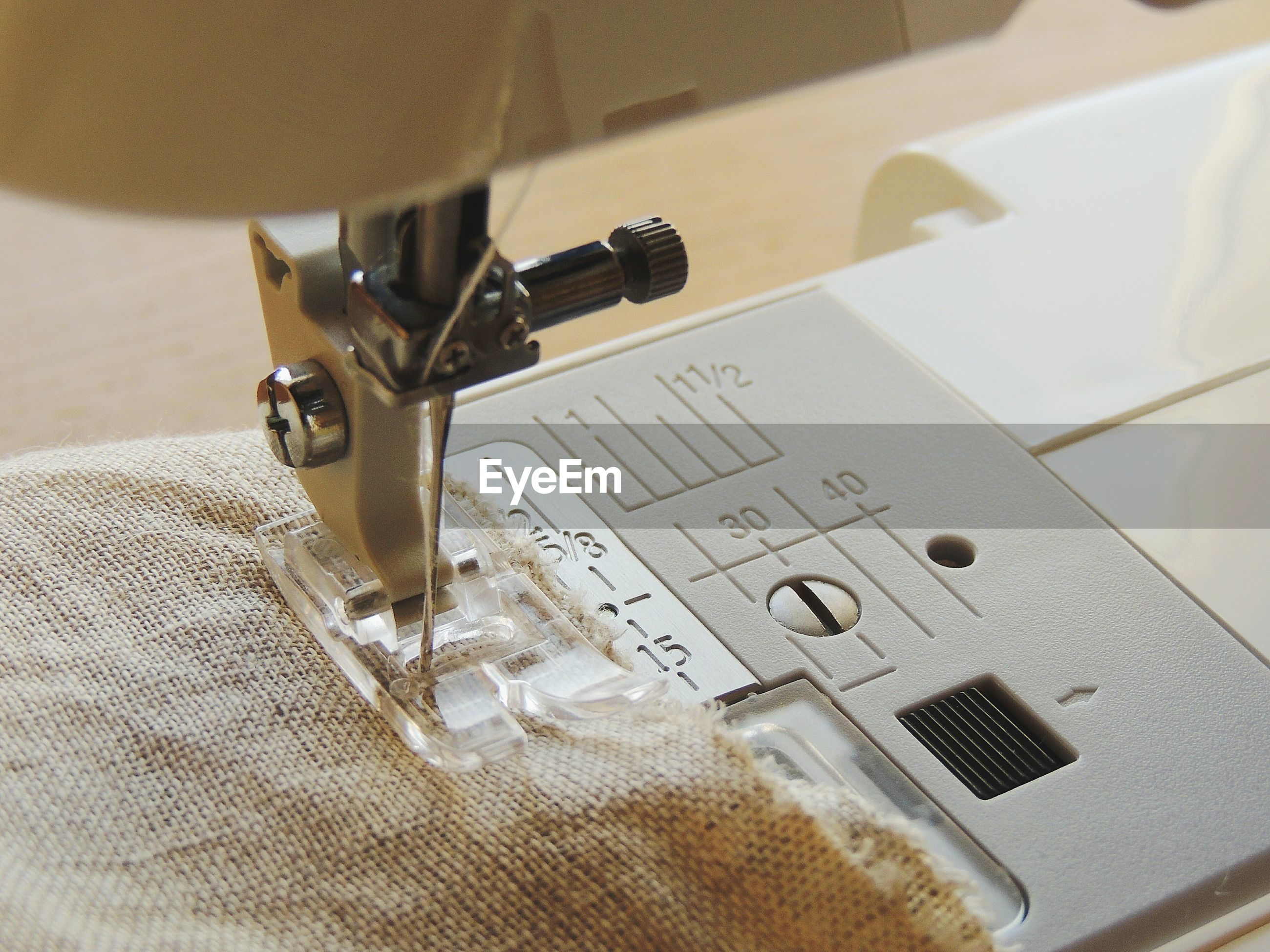 High angle view of burlap on sewing machine