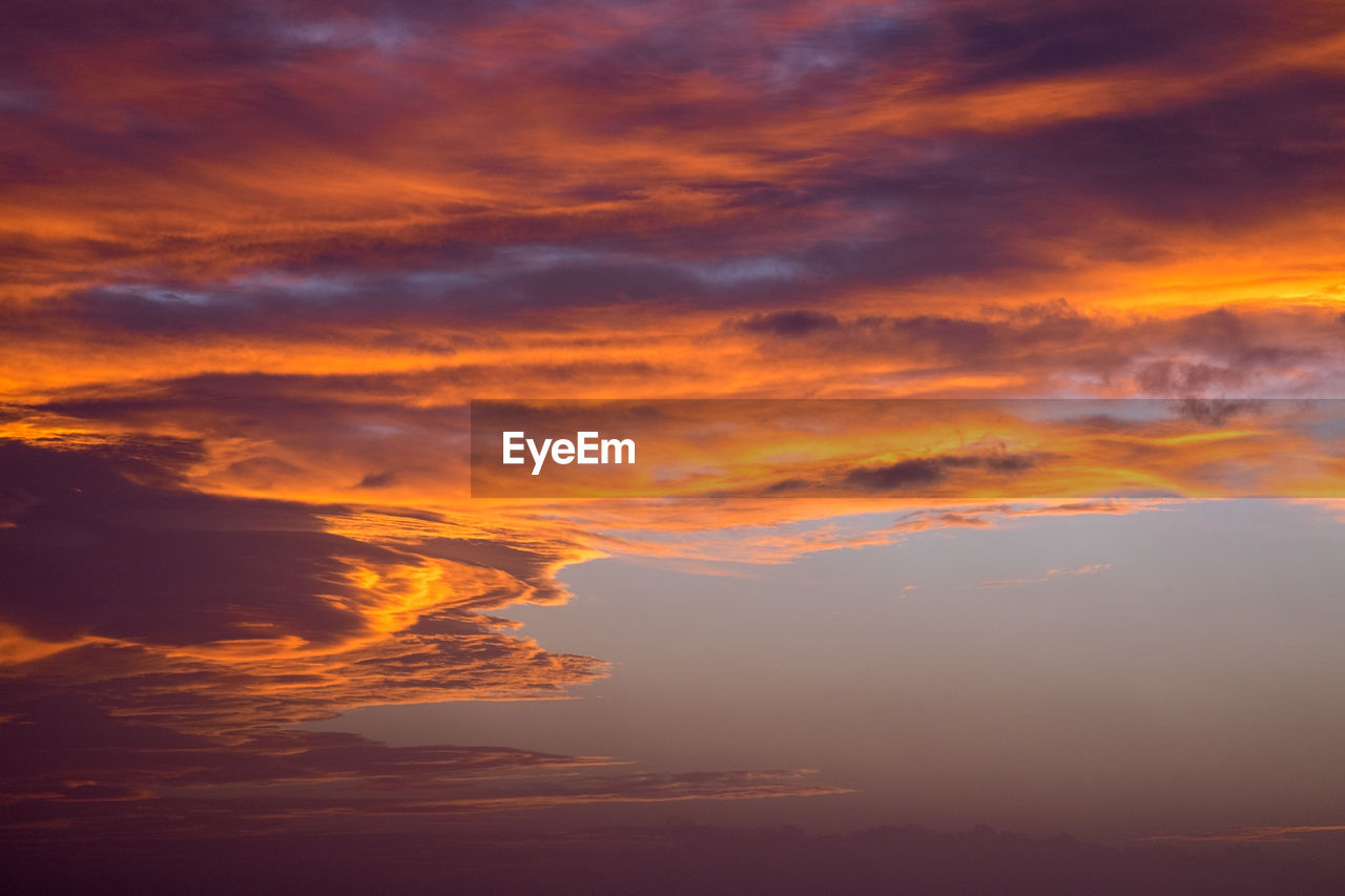 cloud - sky, beauty in nature, sunset, sky, scenics - nature, orange color, tranquility, tranquil scene, idyllic, no people, nature, dramatic sky, cloudscape, outdoors, majestic, environment, awe, low angle view, beauty