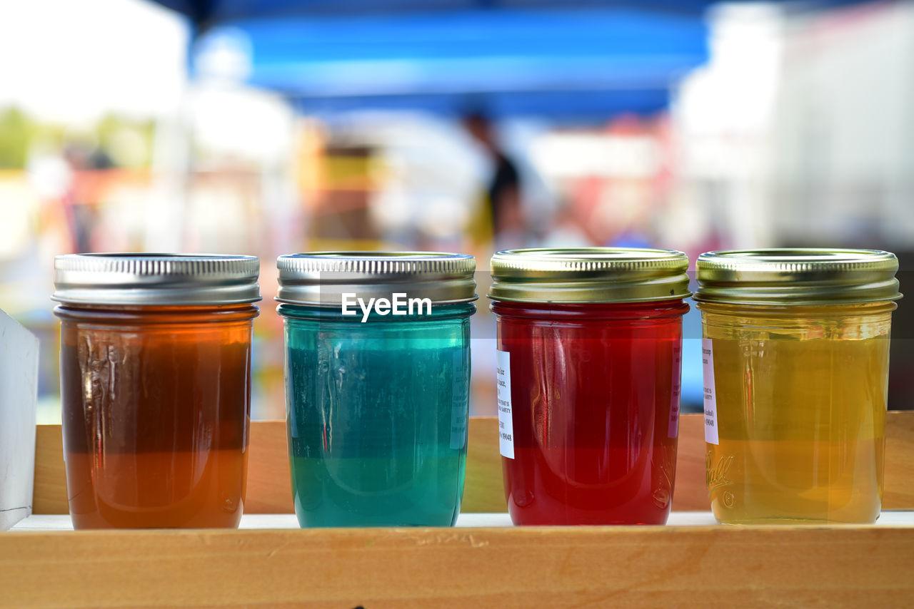 Artisanal jelly in glass jars farmer's market  flavors blue cream soda, blackberry , amaretto ,