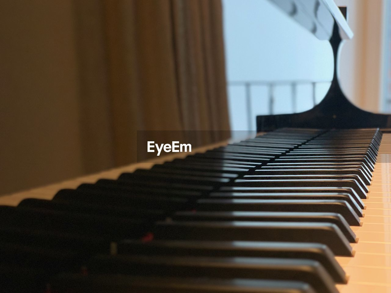 musical instrument, piano, music, musical equipment, arts culture and entertainment, indoors, selective focus, in a row, no people, close-up, piano key, focus on foreground, keyboard, absence, keyboard instrument, day, still life, curtain, string instrument
