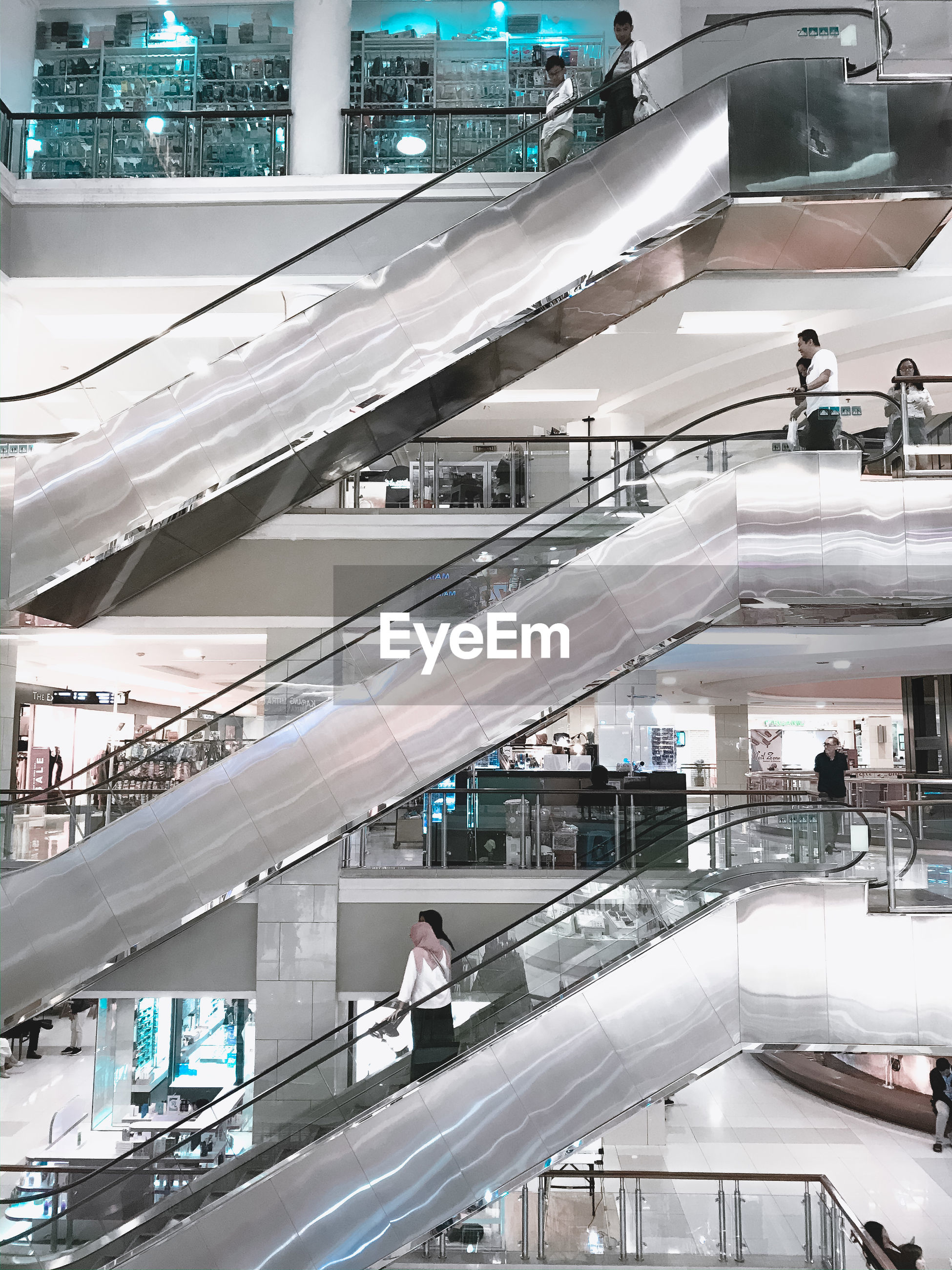 PEOPLE WALKING ON SHOPPING MALL