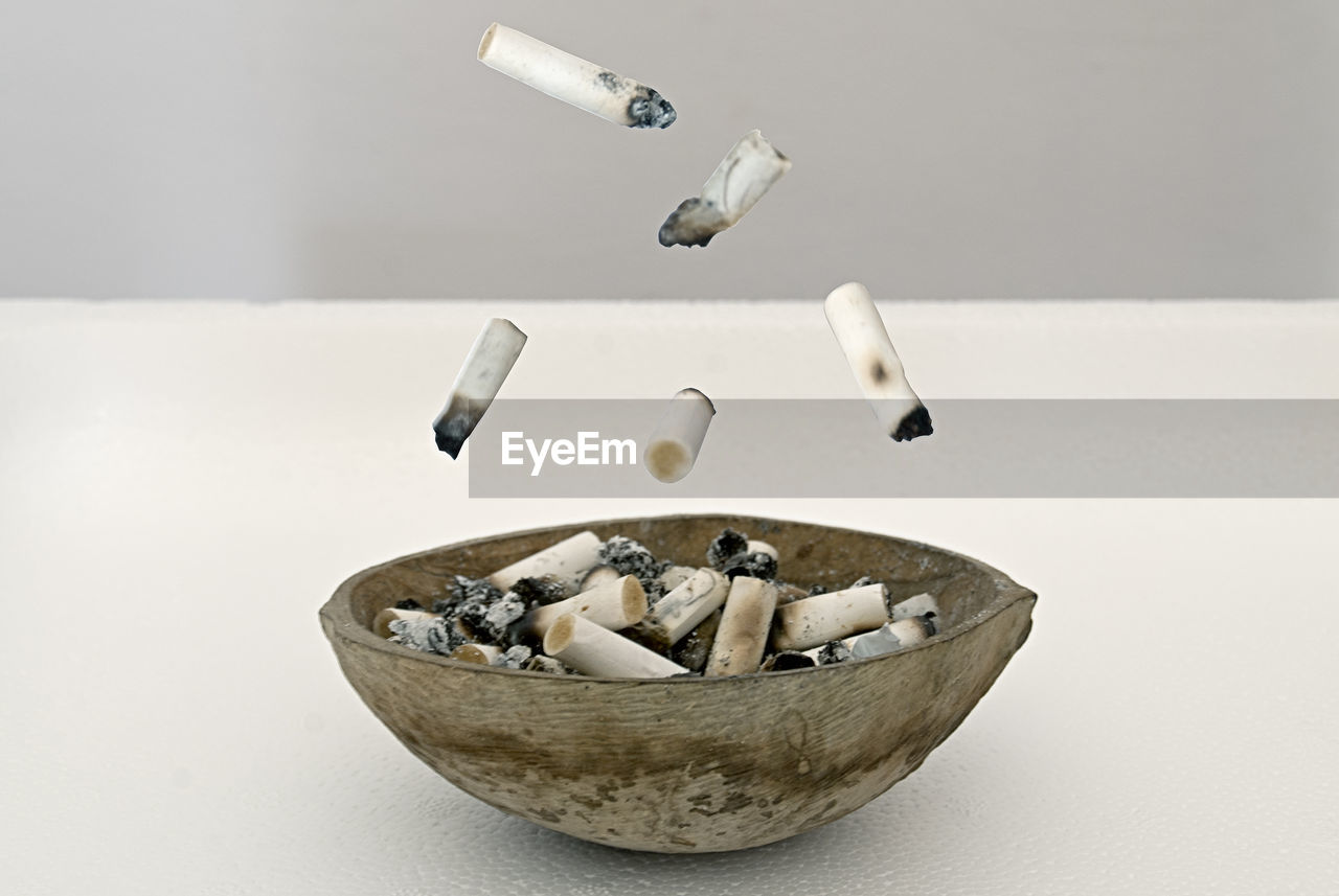 cigarette, indoors, cigarette butt, bad habit, smoking issues, social issues, ashtray, warning sign, risk, sign, no people, studio shot, tobacco product, communication, close-up, burnt, still life, table