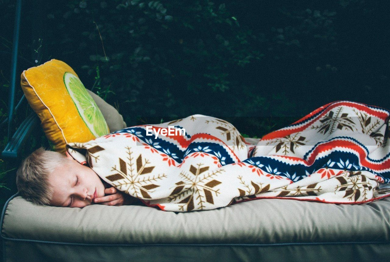 Cute young boy sleeping on couch