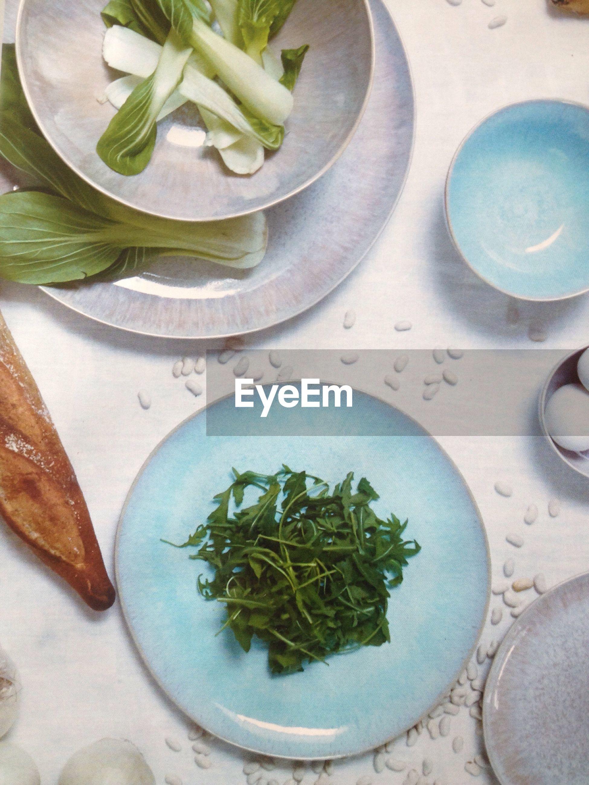 High Angle View Of Food And Plates On Table