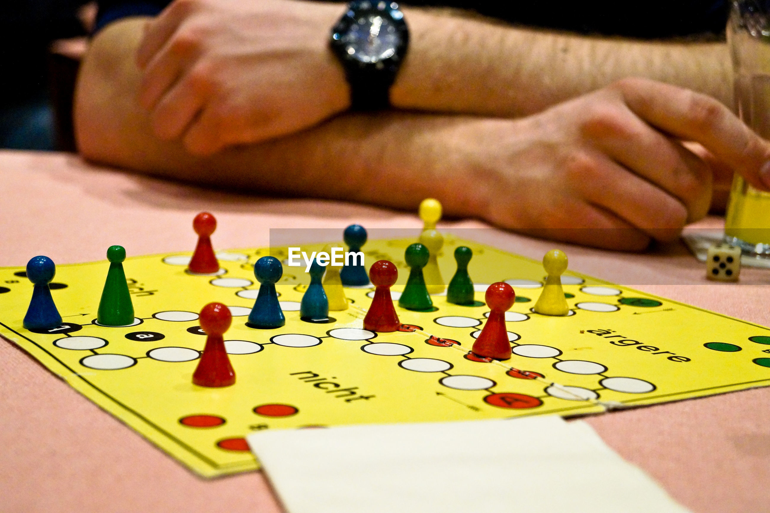 Cropped image of man playing board game