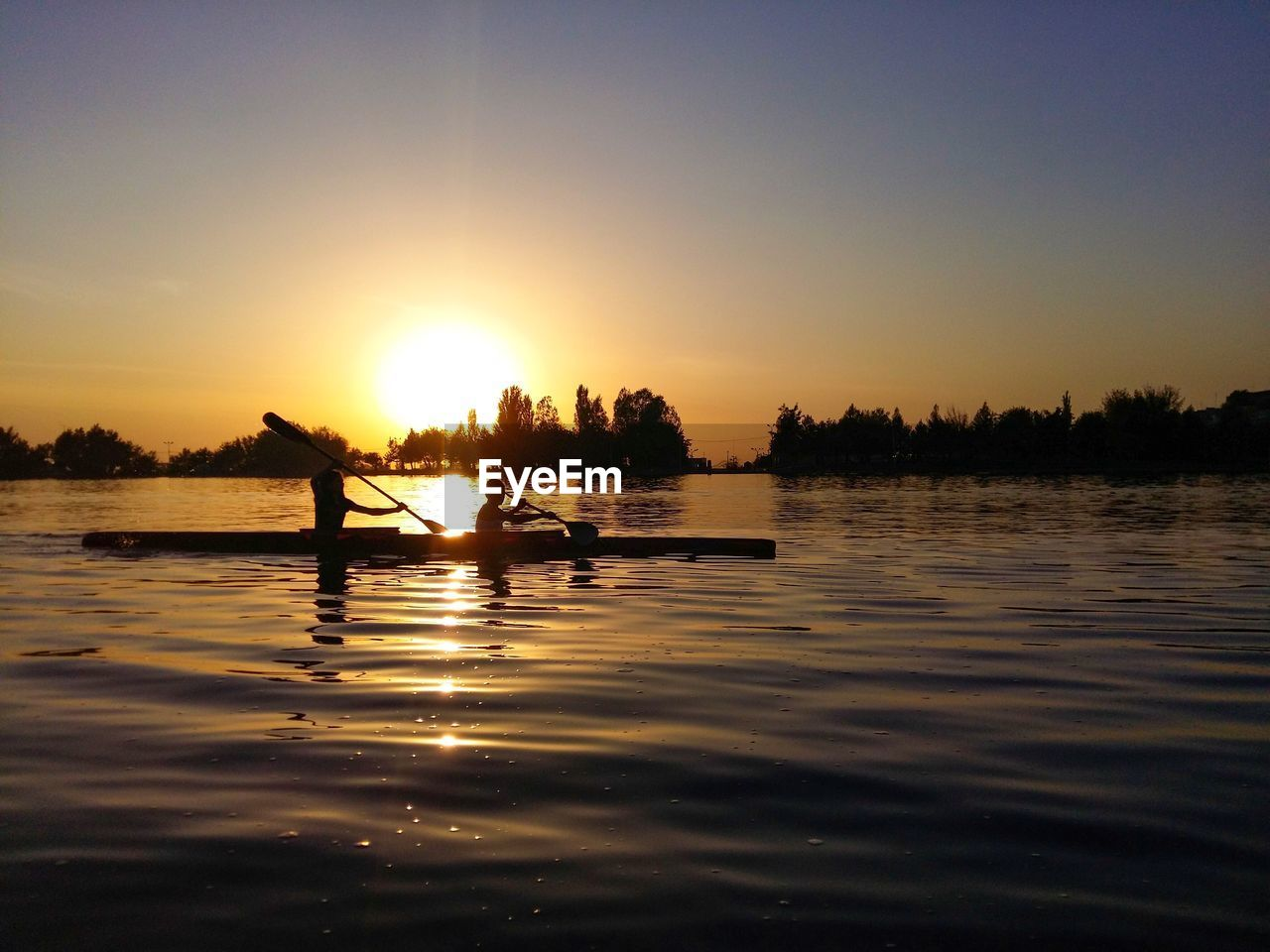 water, sky, sunset, silhouette, real people, nautical vessel, beauty in nature, nature, scenics - nature, sun, waterfront, lifestyles, one person, men, mode of transportation, sunlight, transportation, leisure activity, outdoors, rowing, paddling