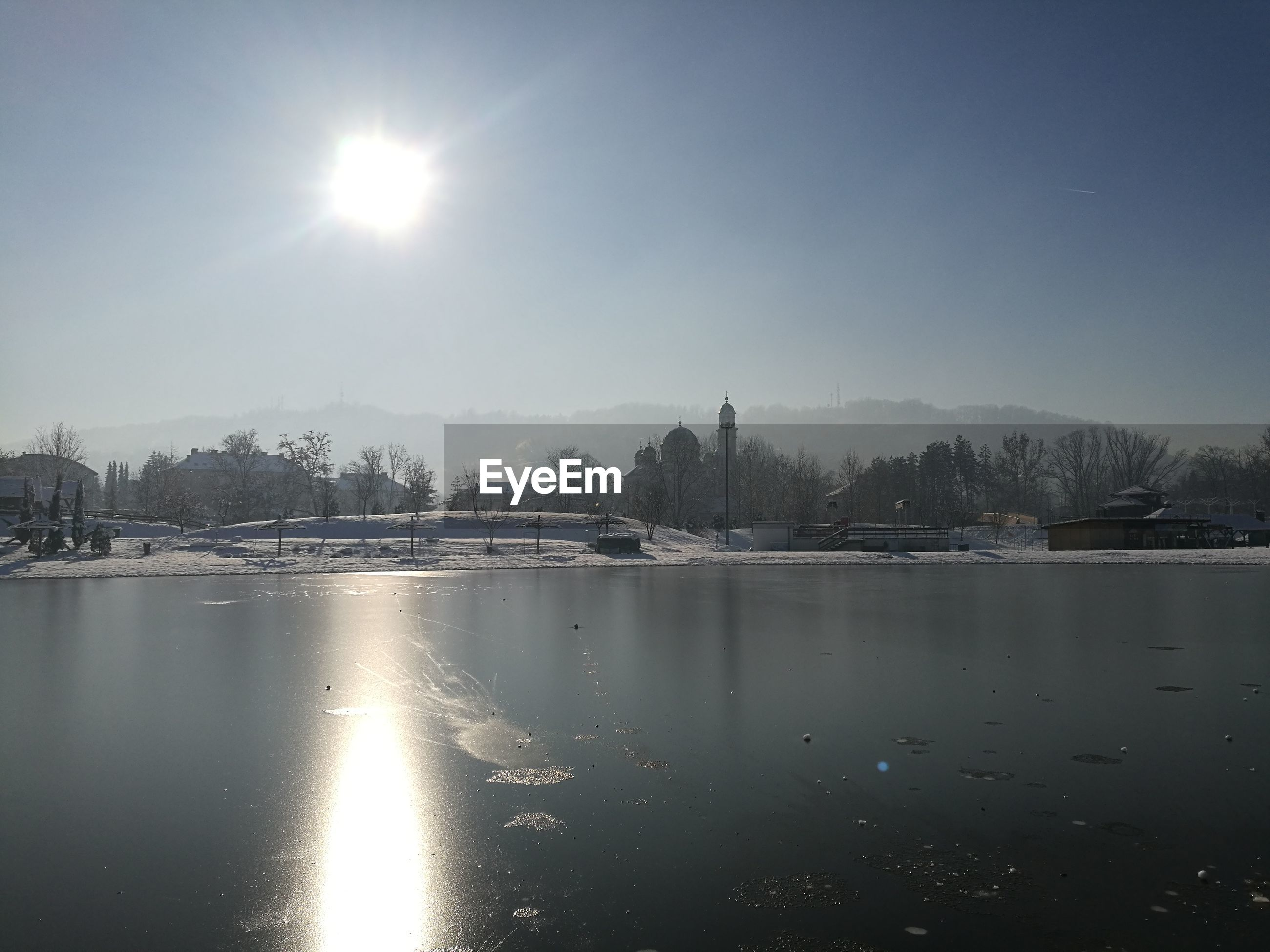 SCENIC VIEW OF LAKE AGAINST CLEAR SKY DURING WINTER