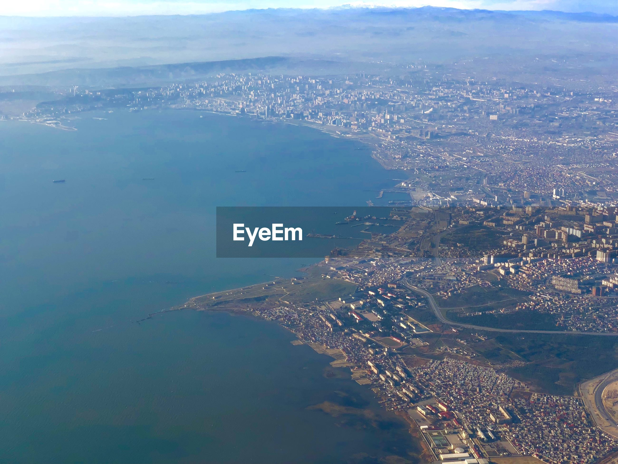 AERIAL VIEW OF CITYSCAPE AND SEA
