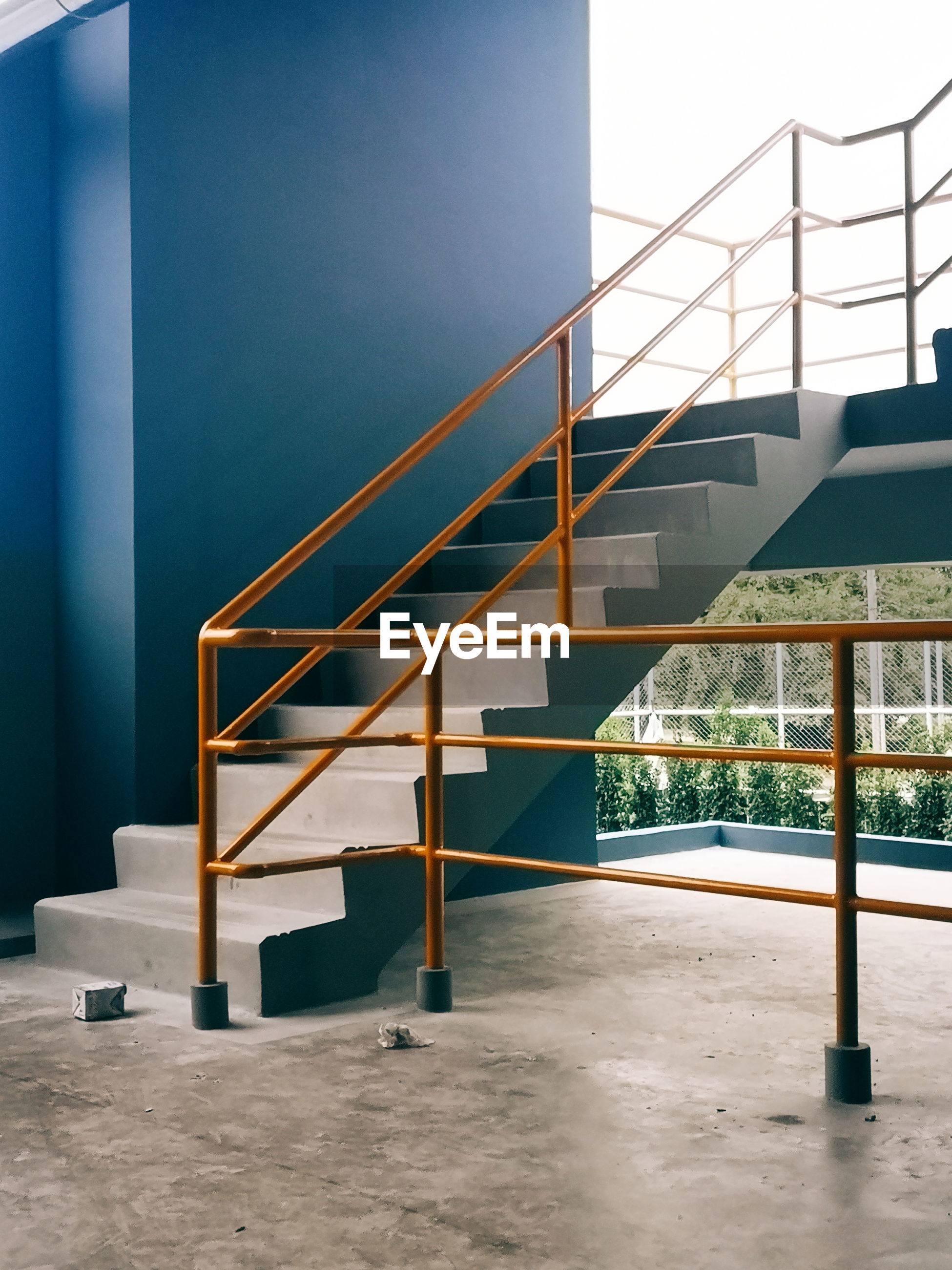 Empty staircase in building against clear sky