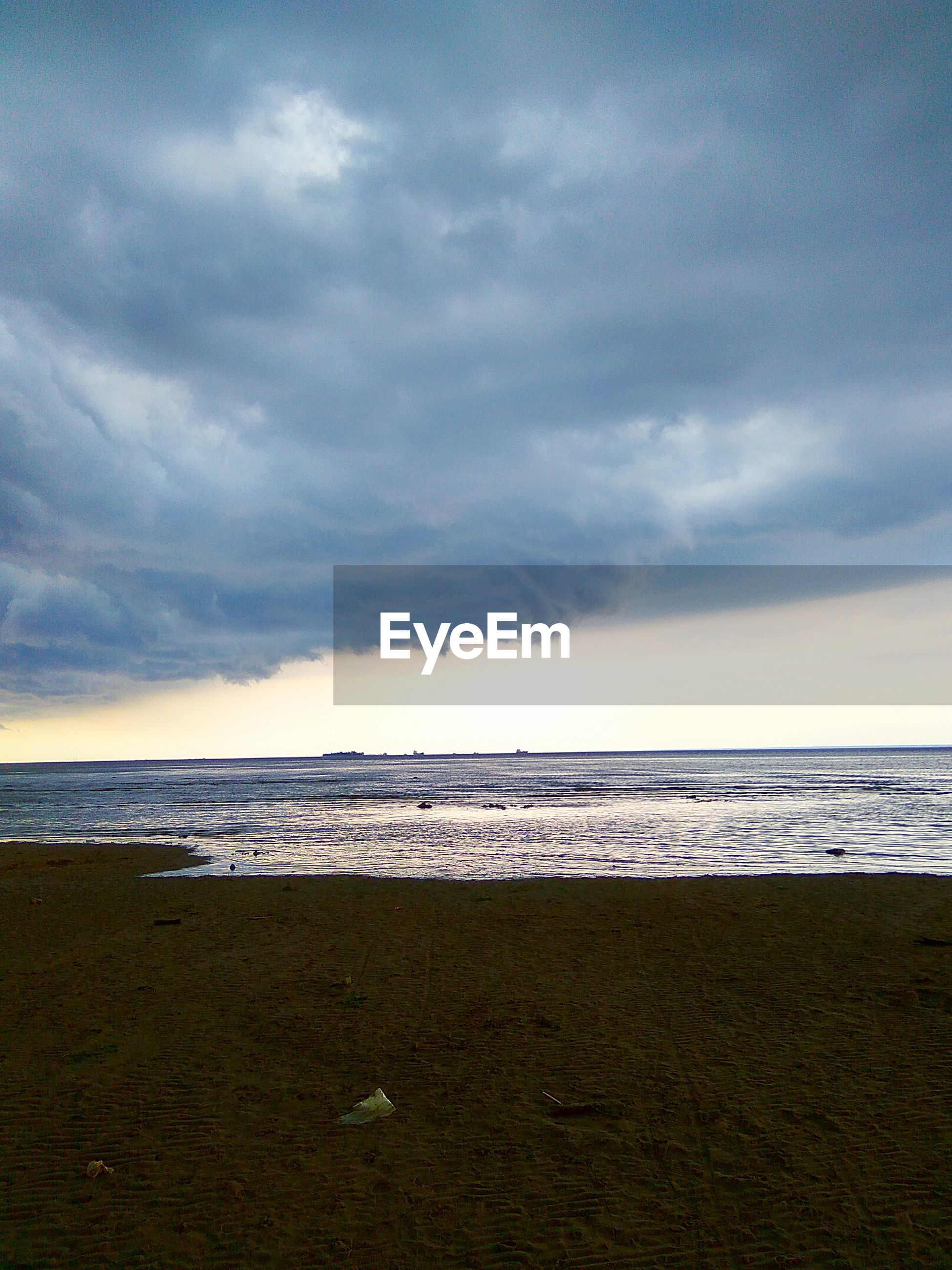beach, sea, sky, horizon over water, tranquil scene, scenics, water, cloud - sky, shore, tranquility, beauty in nature, cloudy, nature, idyllic, cloud, weather, overcast, coastline, remote, outdoors, non-urban scene, dramatic sky, calm, no people, majestic