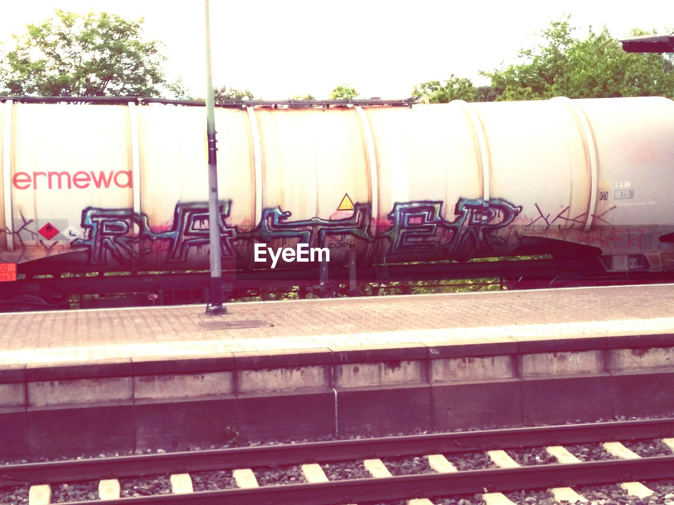 rail transportation, text, railroad track, communication, no people, transportation, train - vehicle, day, outdoors