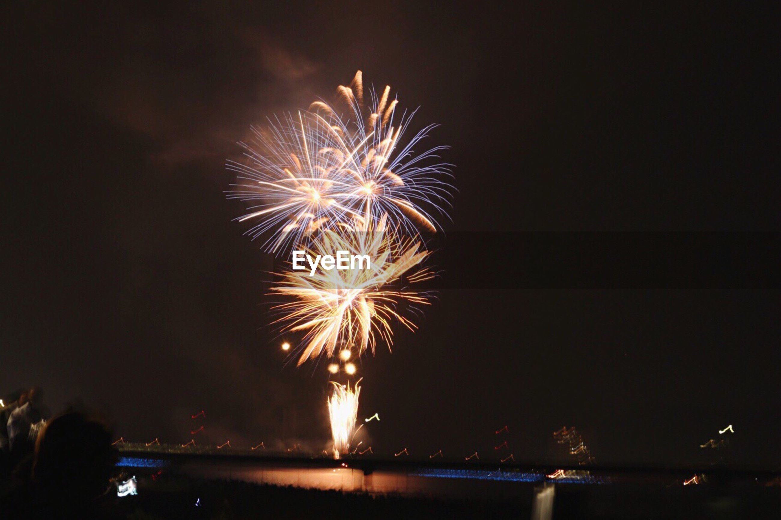 water, night, firework display, celebration, motion, illuminated, firework - man made object, exploding, long exposure, glowing, reflection, sparks, river, sky, entertainment, waterfront, scenics, outdoors, tourism, vacations, sea, event, multi colored