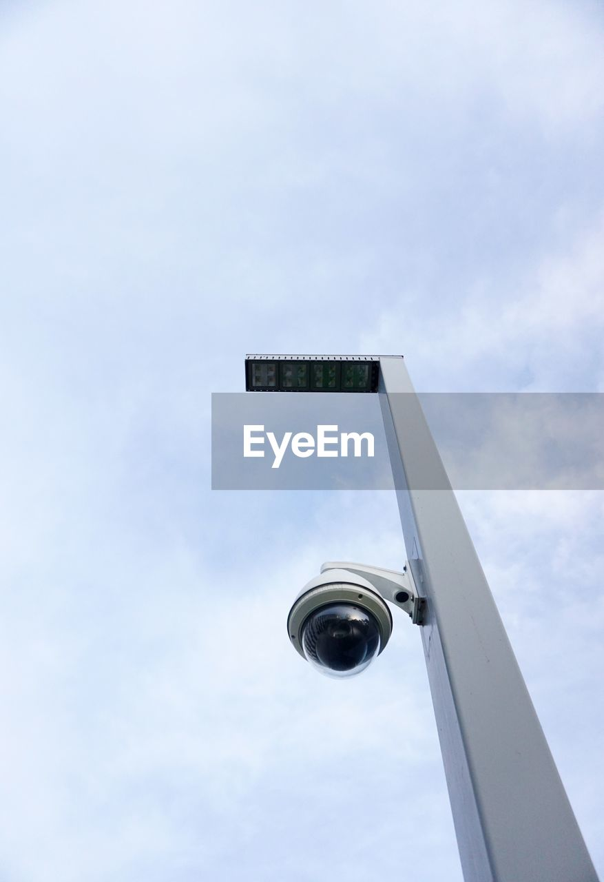 sky, low angle view, cloud - sky, no people, nature, day, built structure, architecture, outdoors, lighting equipment, tall - high, metal, building exterior, pole, technology, sport, communication, geometric shape, sign, blue