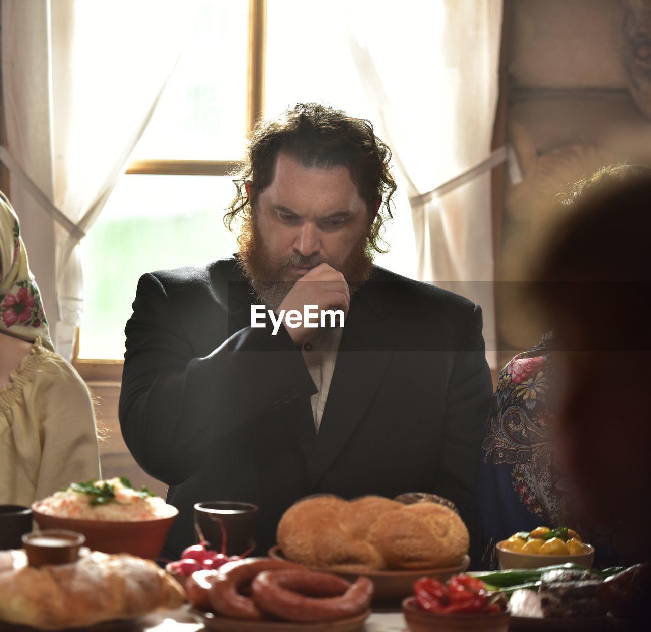 MAN HAVING FOOD