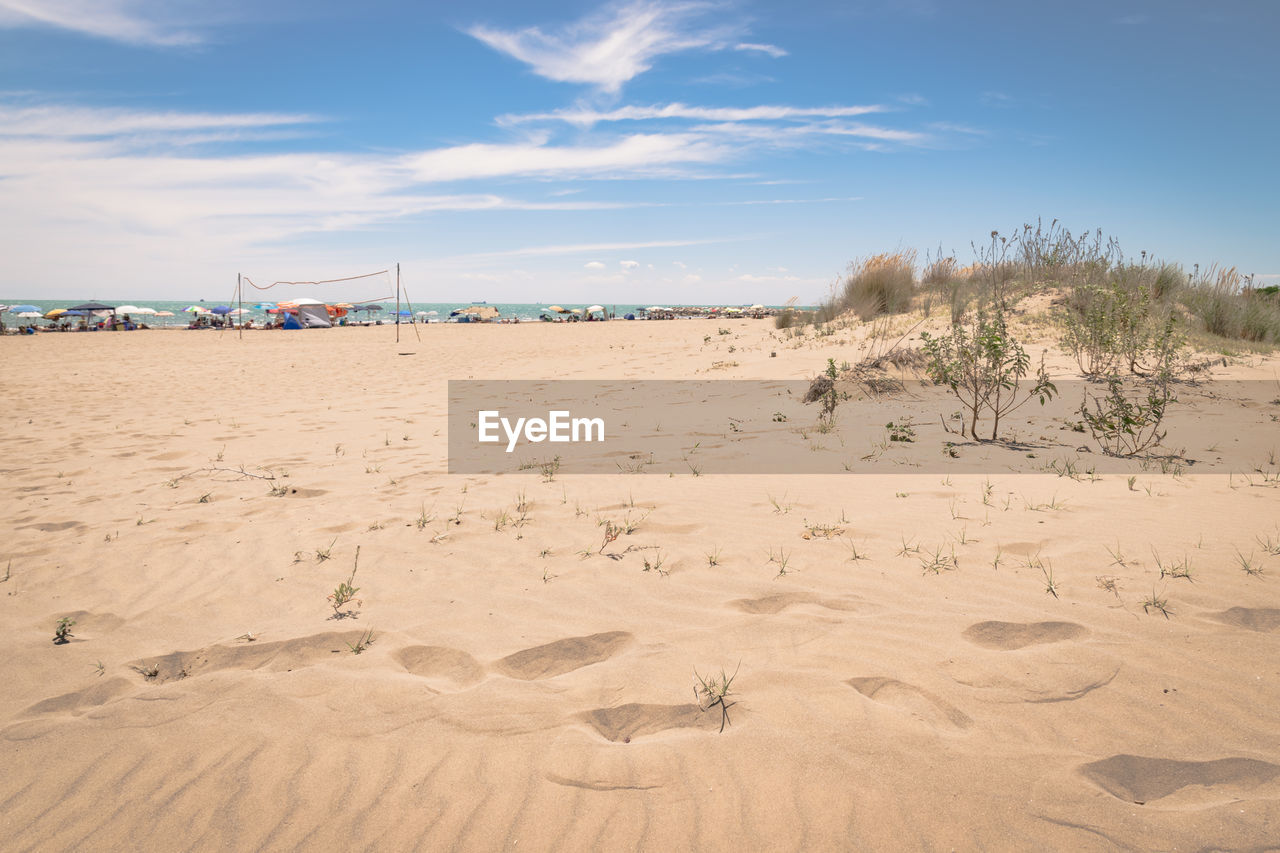 land, sand, sky, scenics - nature, beach, nature, tranquil scene, cloud - sky, tranquility, beauty in nature, non-urban scene, desert, environment, day, landscape, sand dune, arid climate, sunlight, climate, no people, outdoors